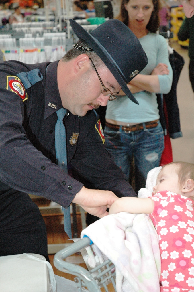 Officer Culbertson Fingerprints Young Child